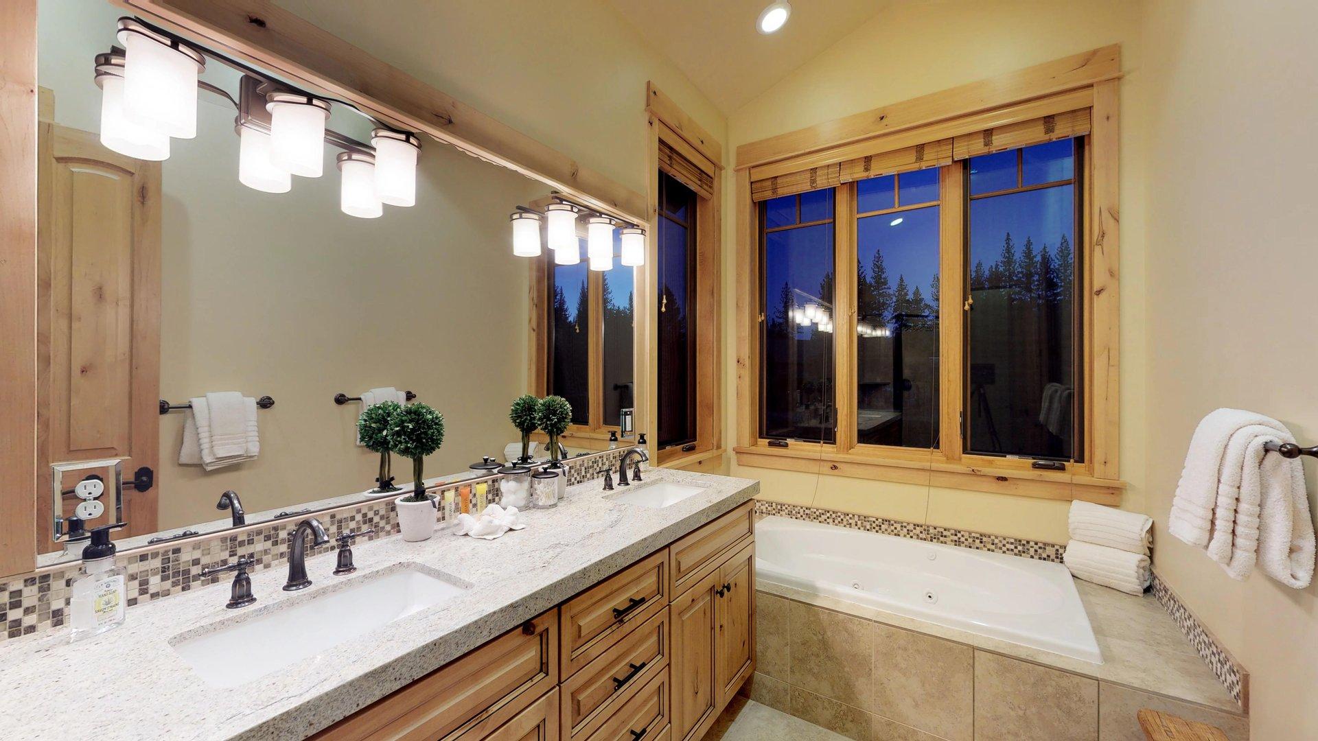 Double Vanity Mirror and Bathtub in Bathroom.