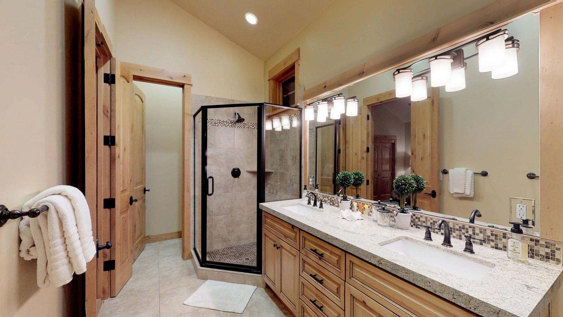 Bathroom Features Double Vanity and Walk-In Shower.
