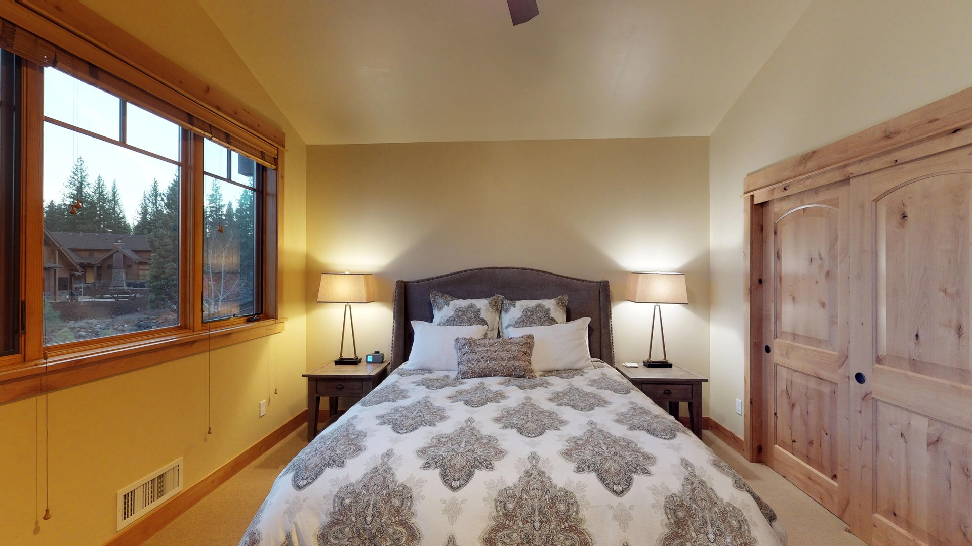 Enjoy Natural Light From Large Windows in Bedroom.