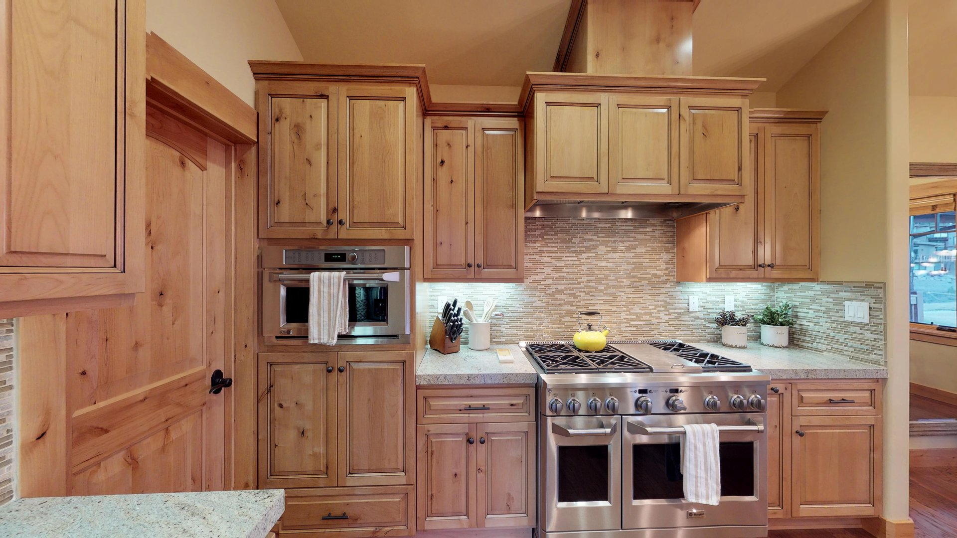 An Image of Wood Cabinets and Stainless Steele Appliances.
