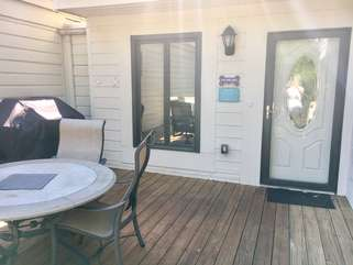 The entrance and outside deck of 774 Spinnaker.