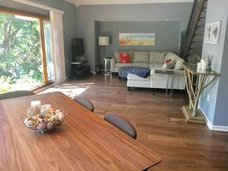 The open living and dining area allow for friends and families to visit.