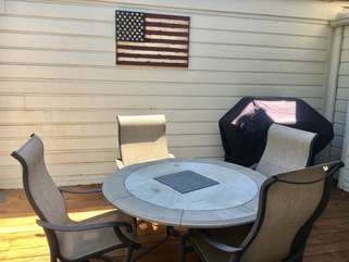 The open deck is a spacious place to enjoy grilling out and dining.
