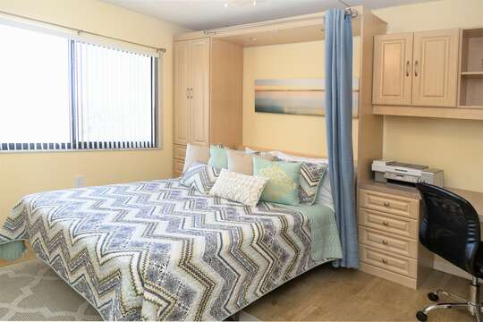 Guest bedroom with Murphy bed & office that easily lifts into the wall with one hand!