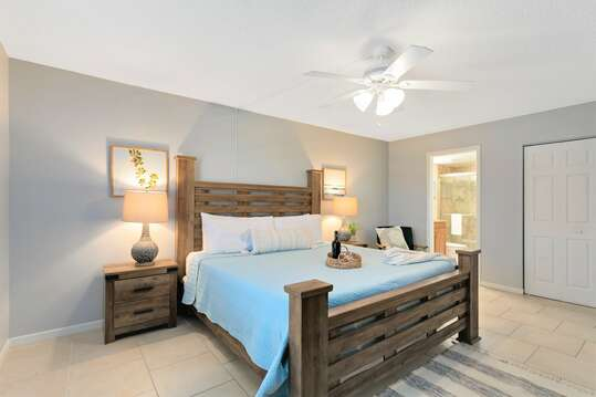 Master bedroom with King bed, closet, TV & ensuite