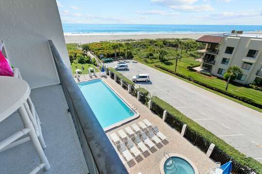 View of the pool, hot tub and ocean from the balcony