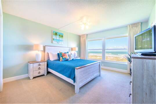 Guest Bedroom #1 with Queen bed, stunning oceanfront views, TV and closet