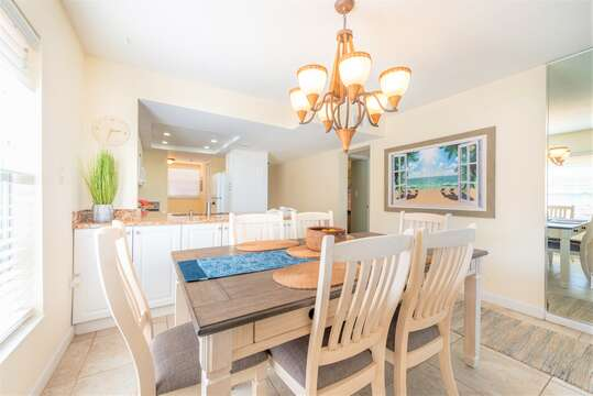 Enjoy meals around this 6 person dining table with views over the pool area