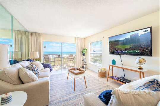 Gorgeous beach casual living room with views from the ocean. Large 65