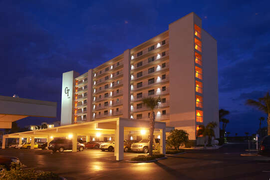 Canaveral Towers at night. You have a private covered parking spot & there is additional parking for your guests