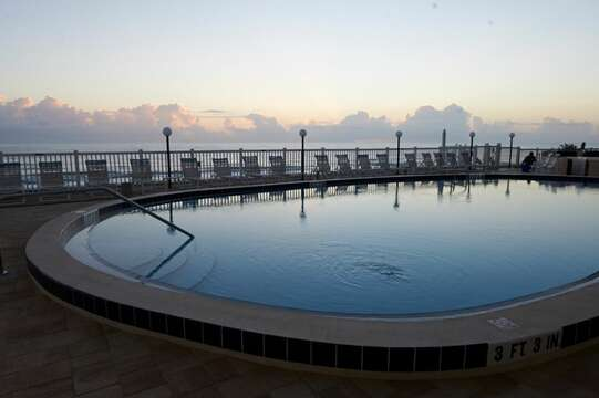 Huge heated oceanfront pool, lots of space and chairs to rest, relax & play