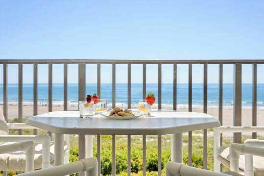 Enjoy a meal on the oceanfront balcony