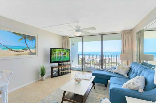 Living room has a pullout couch, LCD TV and amazing OCEAN VIEWS!