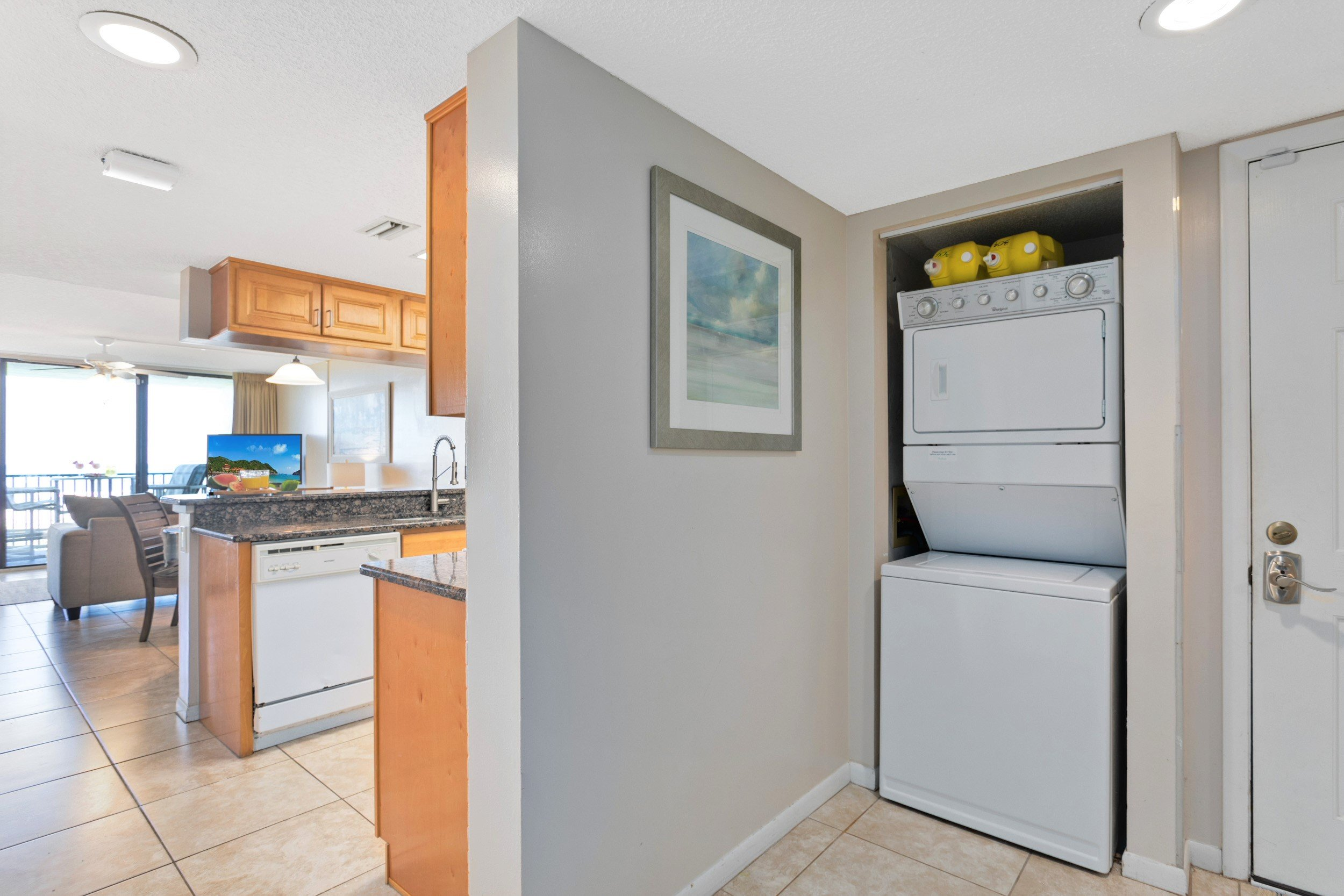 Washer and dryer conveniently located in the unit