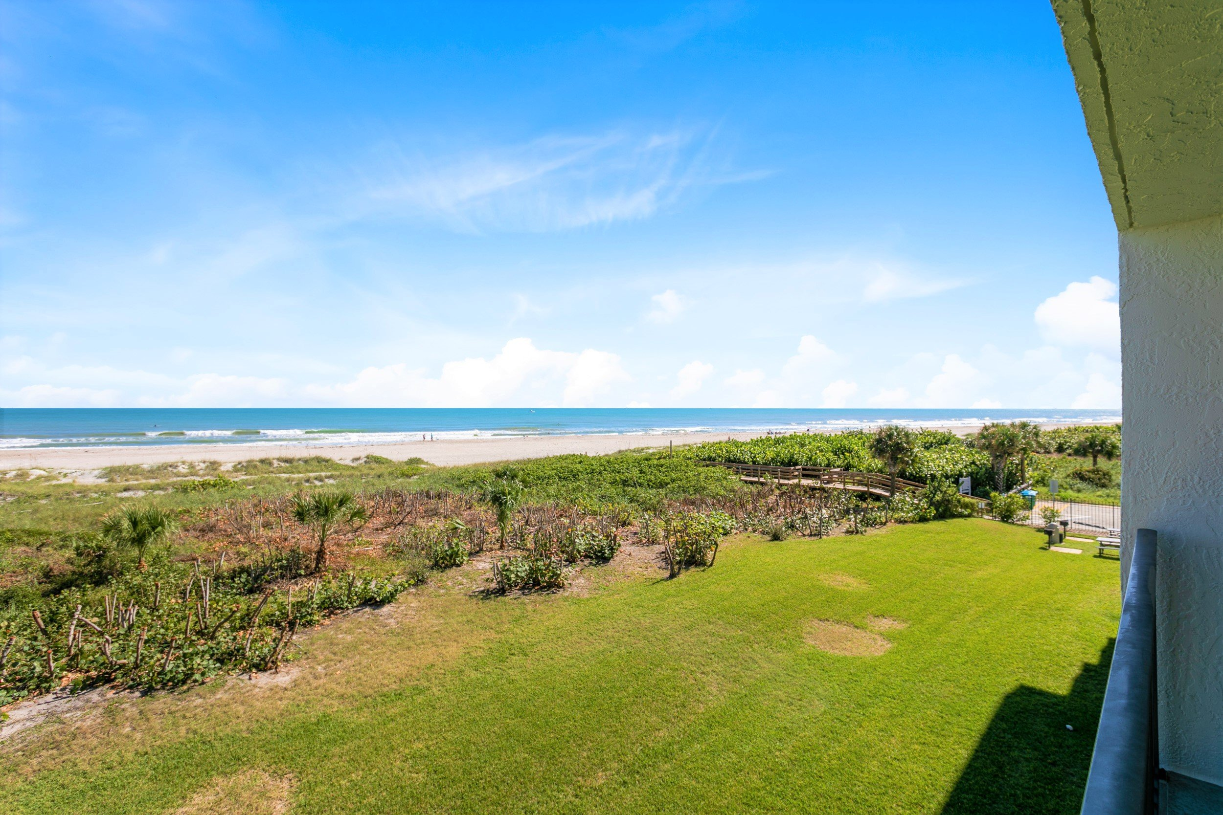 Step onto the wide sandy beach, right from the building!