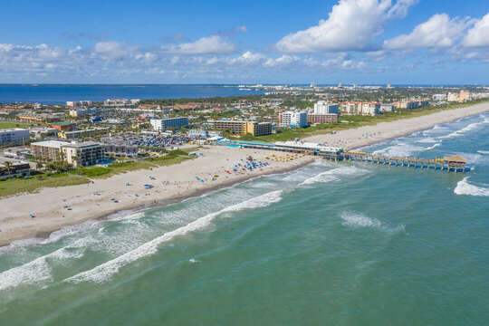Chateau by the Sea (on the left side) is just steps to the famous Cocoa Beach Pier