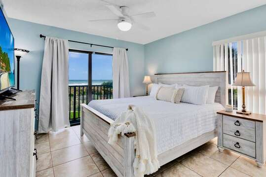 Master bedroom with a king bed and ocean views.
