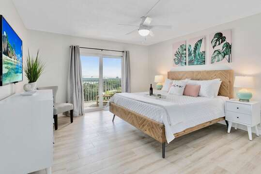 Master bedroom with a king bed and walk out balcony with breath taking views