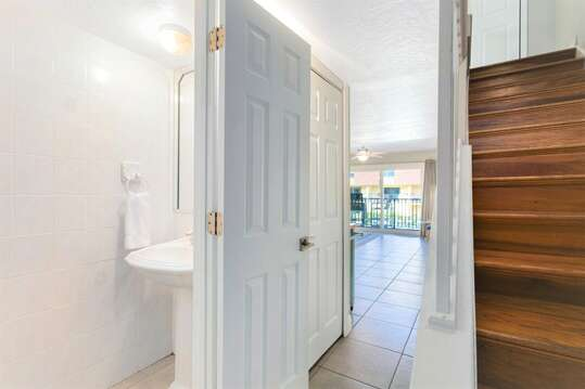 Two level unit has an interior staircase as well as a powder room on the main level