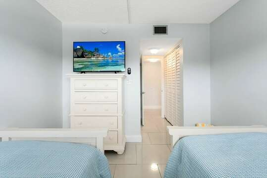 Guest bedroom with TV.