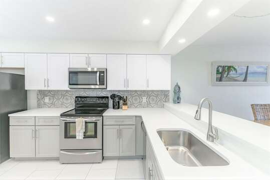 Beautiful and fully renovated kitchen with new cabinets, quartz counters and lots of items to make a delicious meal in!