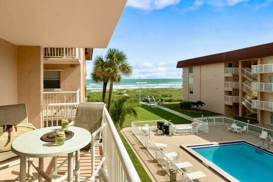 Enjoy your sun exposed balcony with views of the pool and ocean.