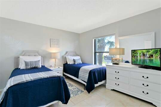 Guest Bedroom with 2 Twin Beds, closet and TV (note: the TV is not in the photo but has since been added)