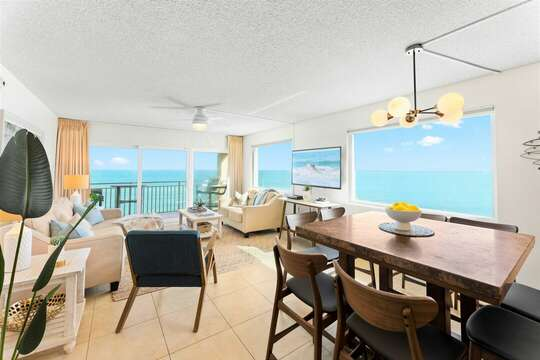 Let the ocean surround you in this comfortable, bright and airy living room. Walk out onto one of two private balconies in the condo