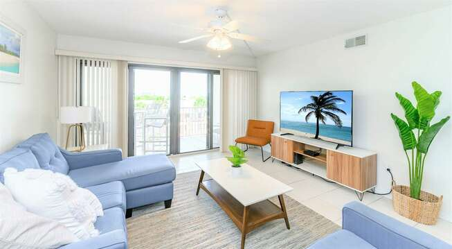 Living room with pullout couch, flatscreen TV - walks out onto your private balcony