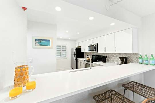 Bright & Coastal Newly renovated kitchen with quartz counters
