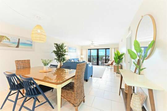 Welcome to Sandcastles 402! This spacious open concept living & dining room walks out onto your private balcony