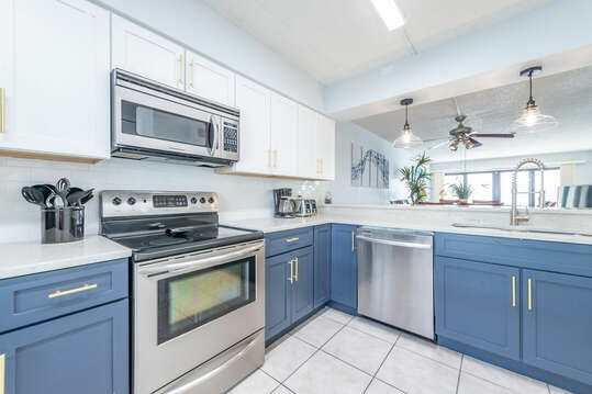 Fully equipped kitchen with stainless steel  appliances & quartz countertops