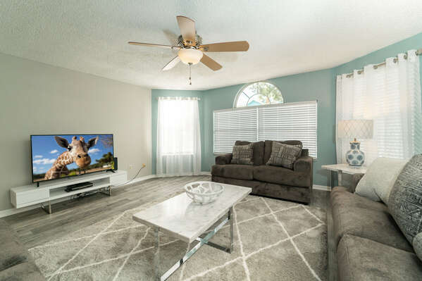 Spacious living room with flat panel TV and DVD