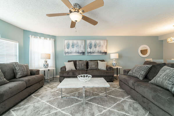 living room seating with 2 sofas and a loveseat