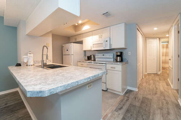 Galley stile kitchen with all you need to prepare most meals in house