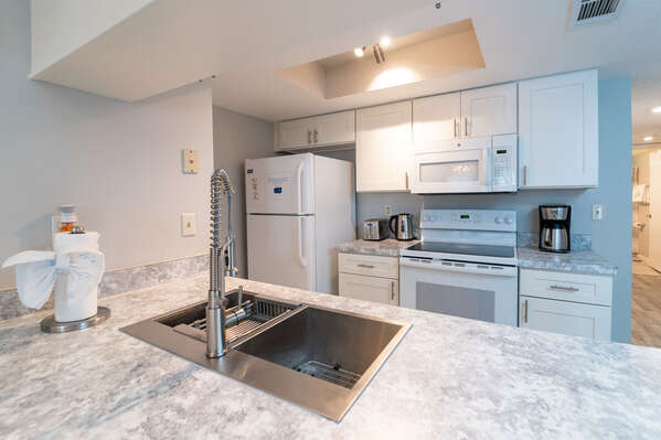 updated kitchen with stainless steel accents