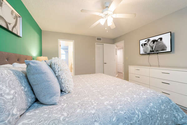 modernized bedroom with wall mounted TV