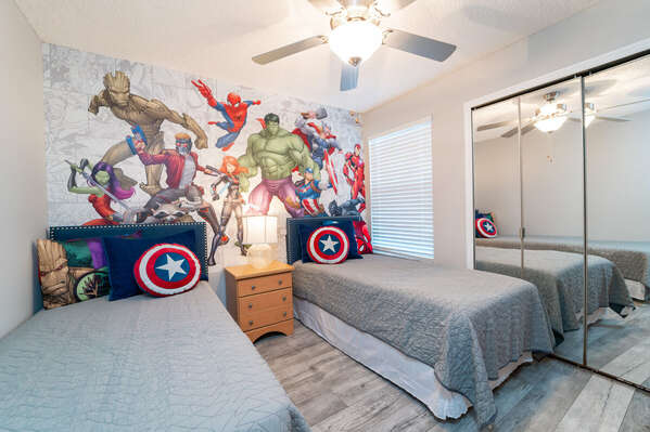 Superhero themed bedroom with 2 twin beds
