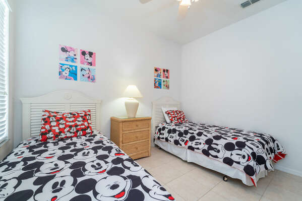 Bedroom 3 has twin beds and a Mickey theme