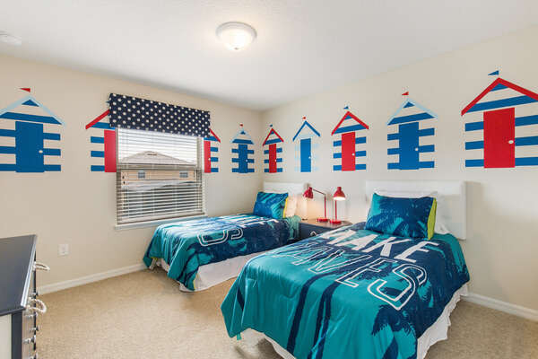 Get in the beach mood with this comfortable twin/twin bedroom