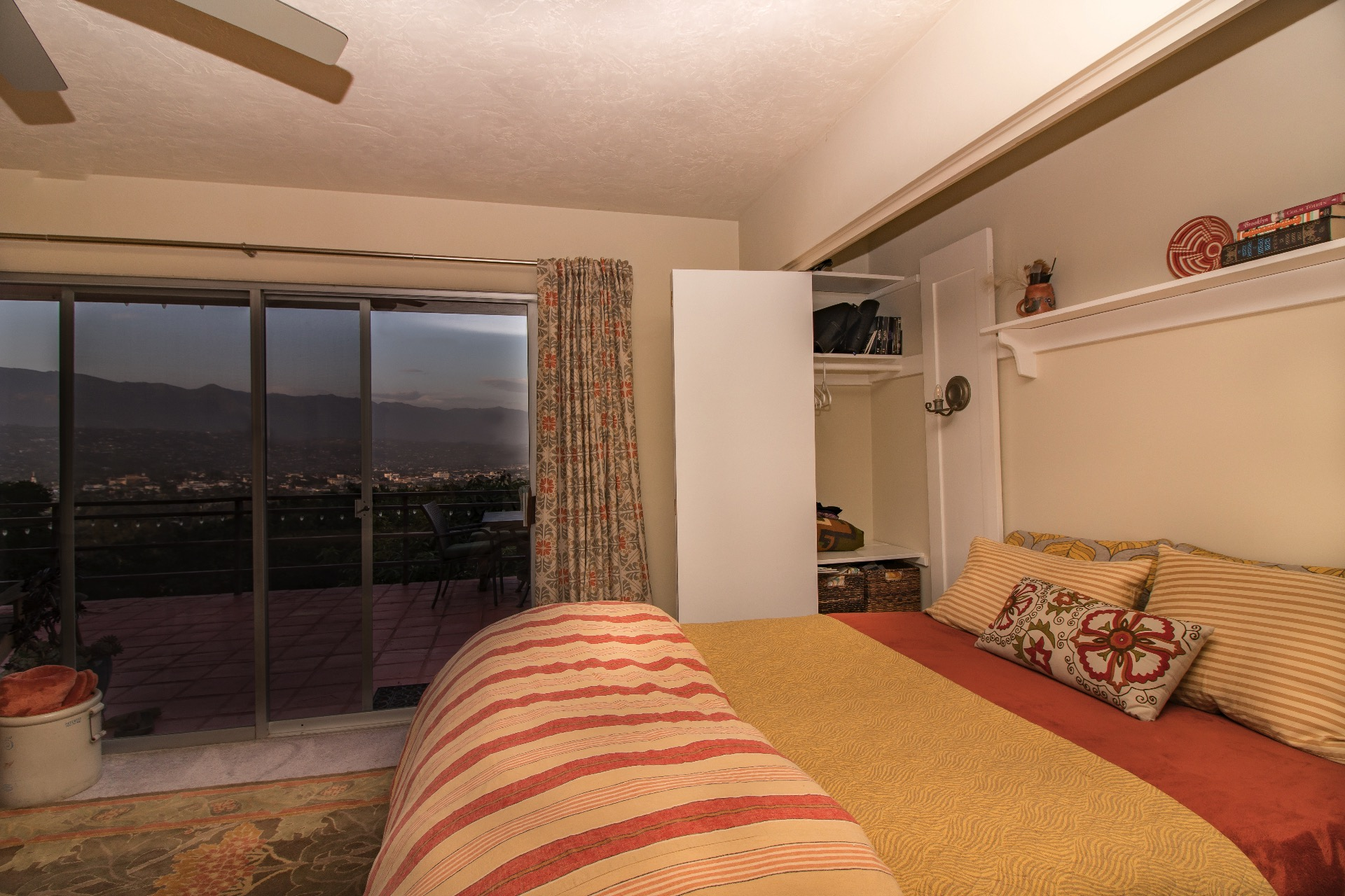 Guest bedroom with a queen murphy bed. Great views and access to the patio.
