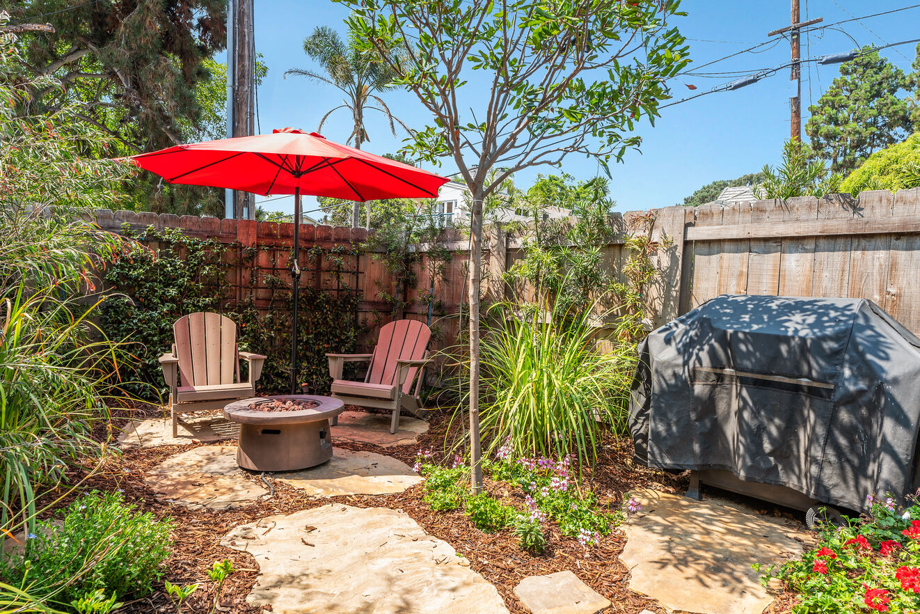 Charming patio with fire fit, BBQ and umbrella for a shaded outdoor dining experience