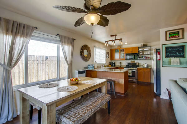 Dining Table, Benches, Ceiling Fan, Sofa, Refrigerator, and the Kitchen.