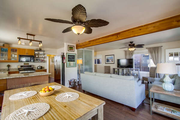Dining Table, Benches, Ceiling Fans, Sofa, TV, and the Kitchen.