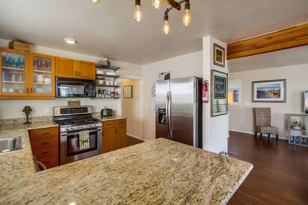 Kitchen Countertop Bar, Refrigerator, and Microwave.