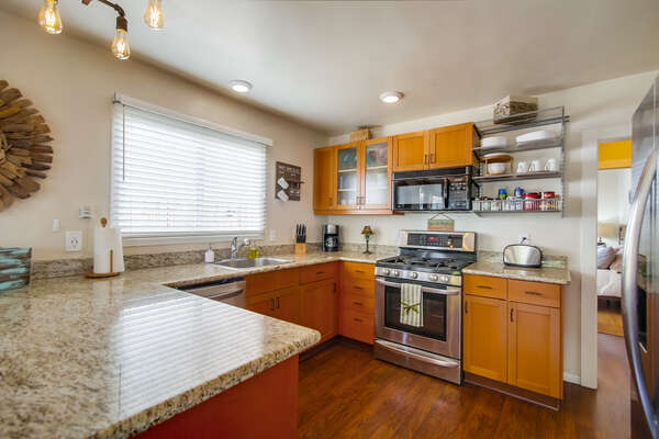 Kitchen with Microwave, Toaster, and Refrigerator.