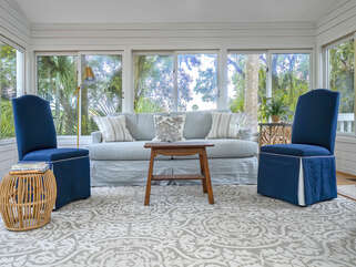 Great Sun Room with a brand new couch , enjoy a book and take a nap