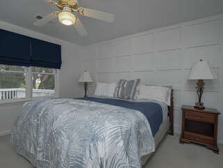 Master bedroom with king bed, flat screen TV and en suite bathroom.