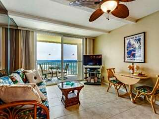 Living Area with Lanai Access and Tropical Furnishings
