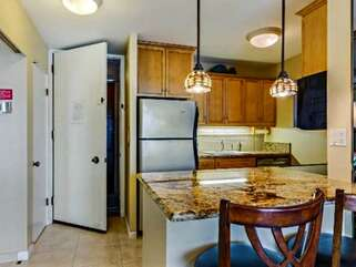 Full Kitchen with Bar Seating for 2 at Oceanfront Rental in Kona